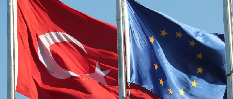 European Union (R) and Turkish flags fly at the business and financial district of Levent in Istanbul, Turkey September 4, 2017. REUTERS/Osman Orsal