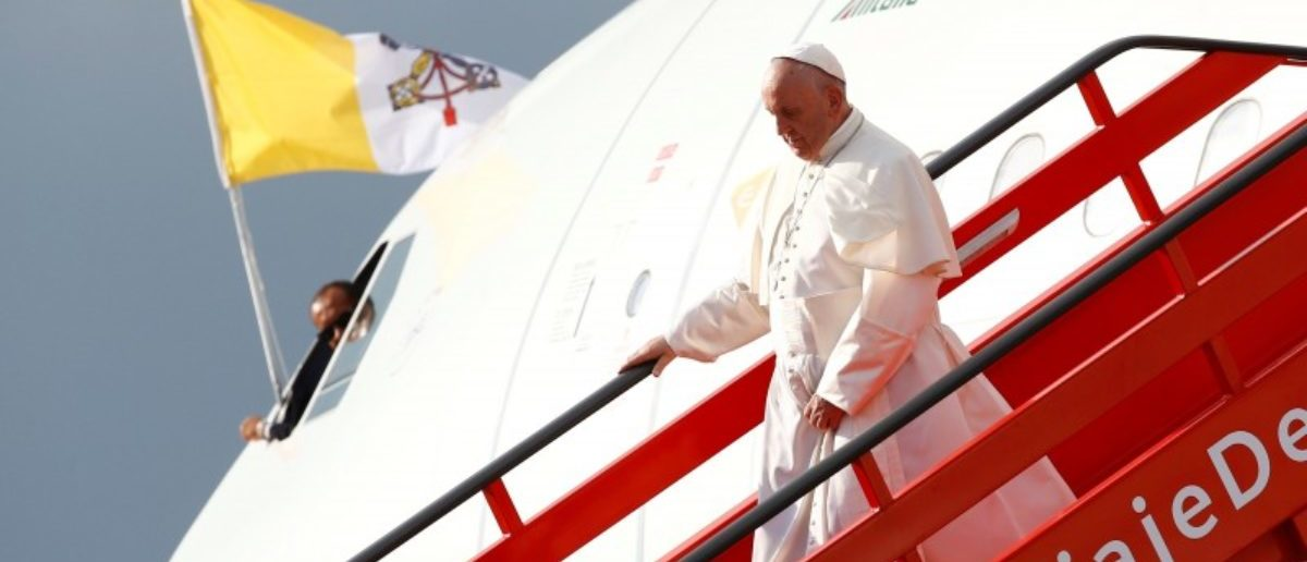 Pope Francis disembarks from the plane after arriving at Bogota