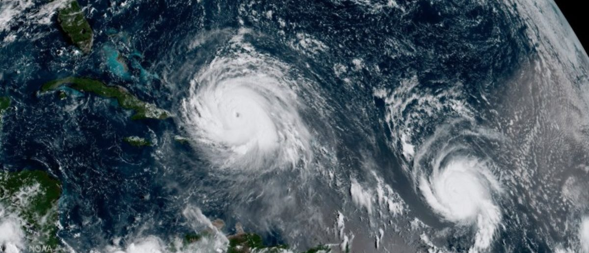Hurricane Irma (L) and Hurricane Jose are pictured in the Atlantic Ocean in this September 7, 2017 NOAA satellite handout photo. NOAA/Handout via REUTERS