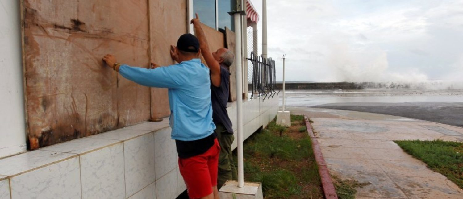 People protect windows with wooden boards ahead of the passing of Hurricane Irma, in Havana, Cuba September 9, 2017. REUTERS/Stringer