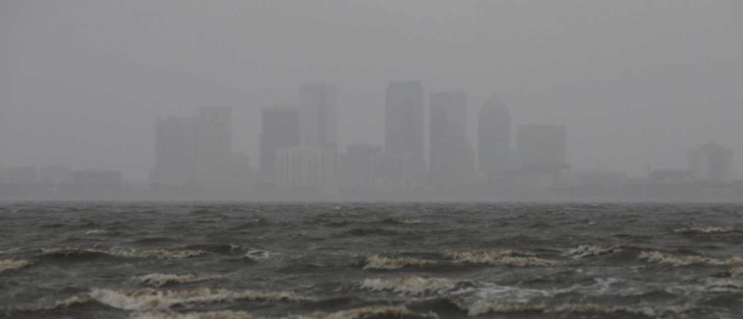 The Tampa skyline is pictured across Hillsborough Bay ahead of the arrival of Hurricane Irma in Tampa, Florida, U.S., September 10, 2017. REUTERS/Chris Wattie