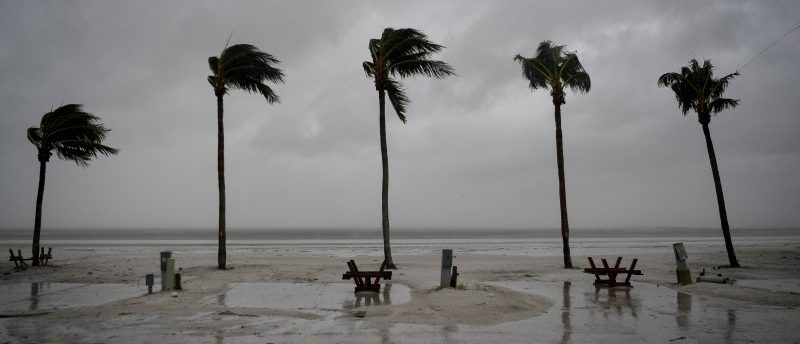 Palm trees sway as the wind blows and water rises at an evacuated recreational vehicle park as hurricane Irma approaches Fort Myers Beach, Florida, U.S., September 10, 2017. REUTERS/Bryan Woolston