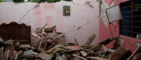 An image of the Sacred Heart of Jesus is seen on the wall of a house destroyed by the earthquake that struck the southern coast of Mexico late on Thursday, in Ixtaltepec