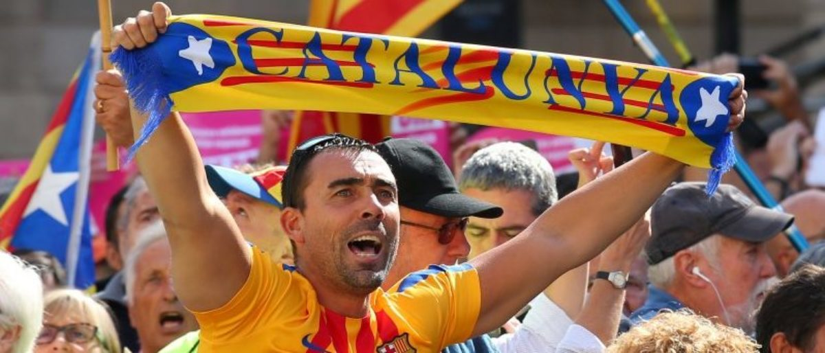 A man raises up a scarf (reads Catalonia) during the Catalans mayors protest in Barcelona, Spain September 16, 2017. REUTERS/Albert Gea