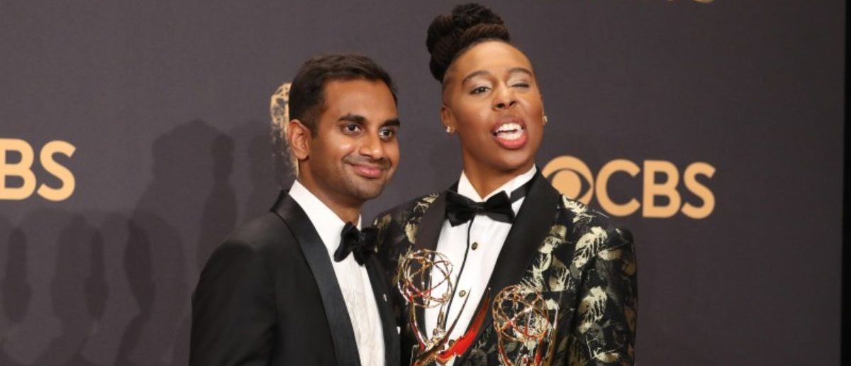 69th Primetime Emmy Awards – Photo Room – Los Angeles, California, U.S., 17/09/2017 - Aziz Ansari (L) and Lena Waithe pose with the Emmy for Outstanding Writing for a Comedy Series for Master of None. REUTERS/Lucy Nicholson