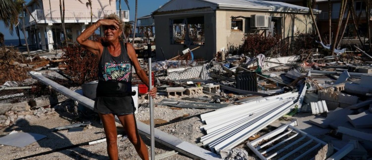 A woman surveys the damage to her mother's house following Hurricane Irma in Big Pine Key, Florida, U.S., September 18, 2017. REUTERS/Carlo Allegri