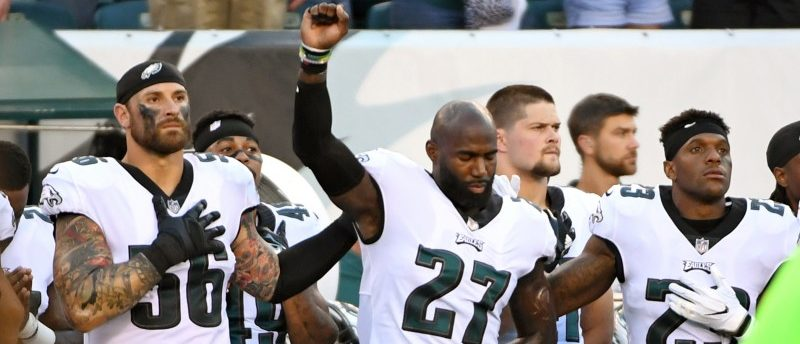 FILE PHOTO: Philadelphia Eagles strong safety Malcolm Jenkins is joined by defensive end Chris Long and free safety Rodney McLeod during the national anthem against the Miami Dolphins in Philadelphia, August 24, 2017. Mandatory Credit: Eric Hartline-USA TODAY Sports