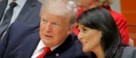U.S. President Trump talks with U.S. Ambassador to the U.N. Haley as they attend a session at UN Headquarters in New York