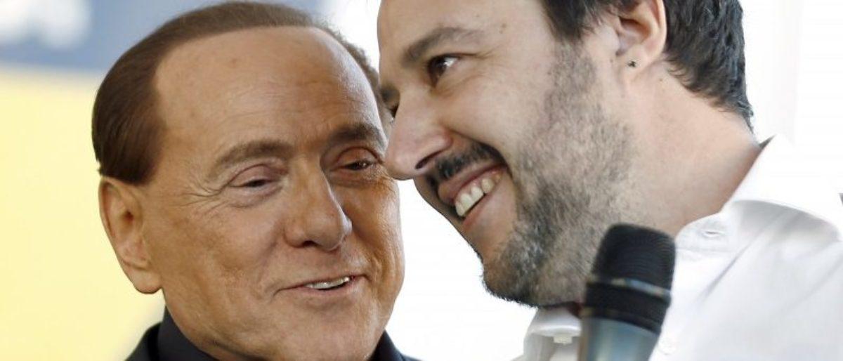 Forza Italia party (PDL) leader Silvio Berlusconi (L) talks with Northern League leader Matteo Salvini during a rally in Bologna, central Italy, November 8, 2015.   REUTERS/Stefano Rellandini/File Photo