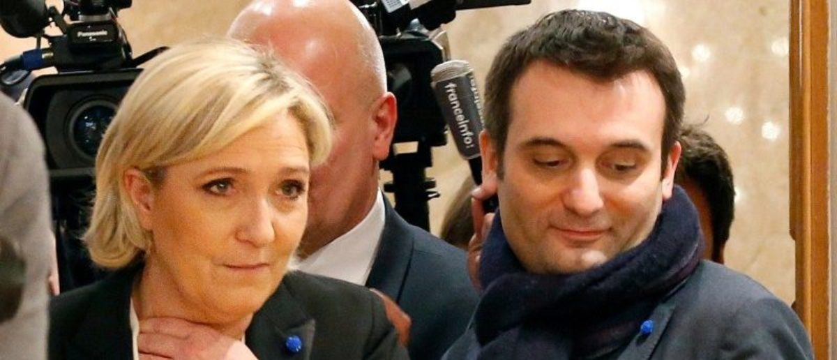 FILE PHOTO - Marine Le Pen (L), French National Front (FN) political party leader and then candidate for French 2017 presidential election, flanked by National Front (FN) party vice-president Florian Philippot (R), arrives to deliver a speech in Paris, France, March 2, 2017. Philippot, the right-hand man of French National Front leader Marine Le Pen quit the party September 21, 2017, raising the prospect of a split in the far-right's ranks after Le Pen's defeat in the May presidential election and months of internal feuding. Picture taken March 2, 2017. REUTERS/Charles Platiau/File Photo
