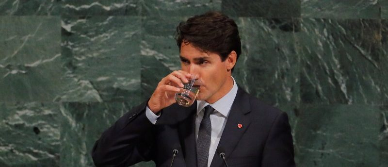 Canadian Prime Minister, Justin Trudeau, takes a drink as he addresses the 72nd United Nations General Assembly at U.N. headquarters in New York, U.S., September 21, 2017. REUTERS/Lucas Jackson
