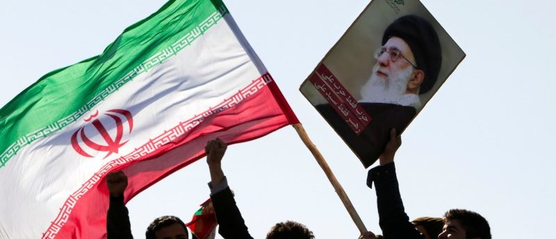 FILE PHOTO: Demonstrators wave Iran's flag and hold up a picture of supreme leader Ayatollah Ali Khamenei during a ceremony to mark the 33rd anniversary of the Islamic Revolution, in Tehran's Azadi square February 11, 2012.    REUTERS/Raheb Homavandi/File Photo
