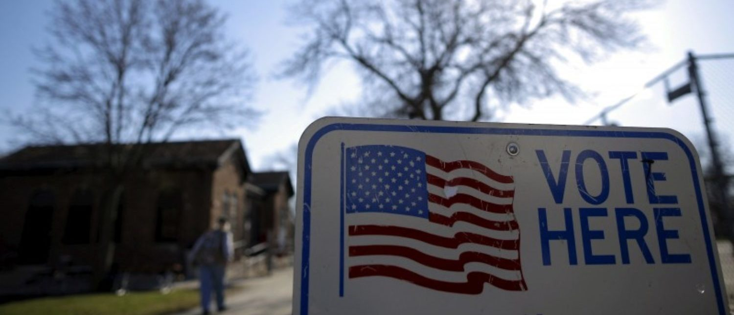FILE PHOTO: A voter arrives to cast their ballot in the Wisconsin presidential primary election at a voting station in Milwaukee, Wisconsin, U.S. on April 5, 2016. REUTERS/Jim Young/File Photo