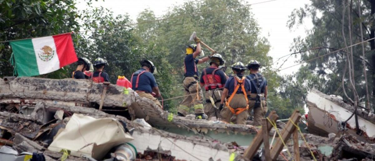 Mexican fire fighters work through the rubble of a collapsed multi family residential, after an earthquake, in Mexico City