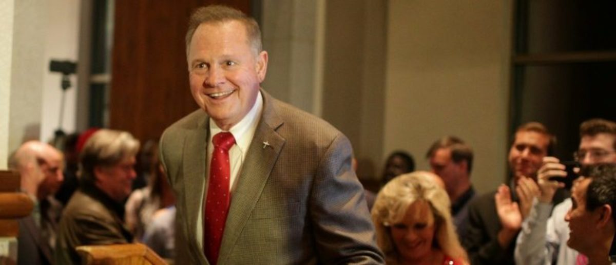 Republican candidate Roy Moore enters the stage to make his victory speech after defeating incumbent Luther Strange to his supporters at the RSA Activity center in Montgomery, Alabama, U.S. September 26, 2017, during the runoff election for the Republican nomination for Alabama's U.S. Senate seat vacated by Attorney General Jeff Sessions. REUTERS/Marvin Gentry