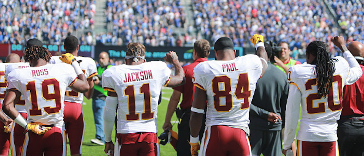 EAST RUTHERFORD, NJ - SEPTEMBER 25: Rashad Ross #19, DeSean Jackson #11, Niles Paul #84, and Greg Toler #20 of the Washington Redskins raise their fists during the national anthem prior to the game against the New York Giants at MetLife Stadium on September 25, 2016 in East Rutherford, New Jersey. (Photo by Michael Reaves/Getty Images)