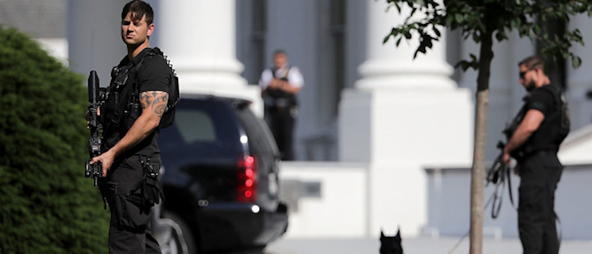 WASHINGTON, DC - MAY 31: Secret Service officers stands guard on the North Lawn of the White House following a temporary lock down May 31, 2017 in Washington, DC. The reason for the extra security was not immediately given. (Photo by Chip Somodevilla/Getty Images)
