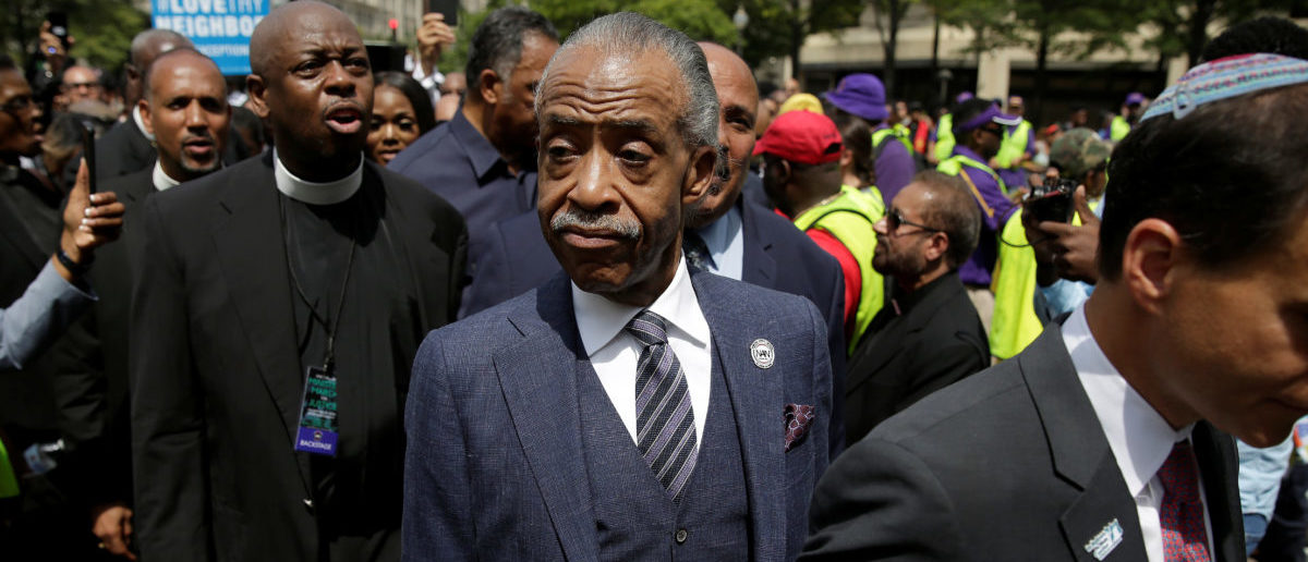 Reverend Al Sharpton walks after leading a march to the Department of Justice during the 1,000 Ministers March for Justice in Washington, U.S., August 28, 2017. REUTERS/Joshua Roberts