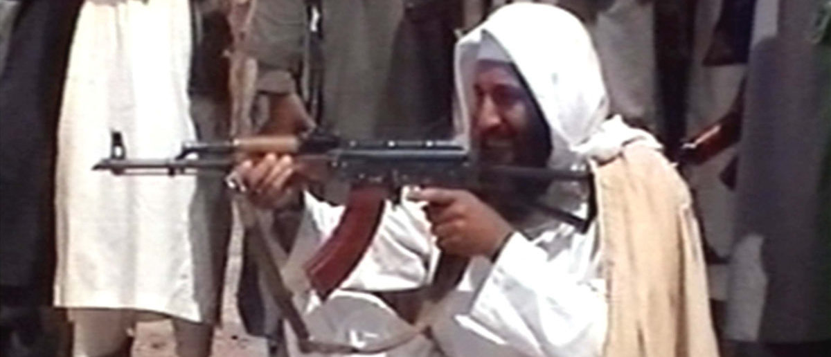 Saudi-born terrorist suspect Osama bin Laden is seen aiming a weapon in this undated photo from Al-Jazeera TV. (Photo by Al-Jazeera/Getty Images)