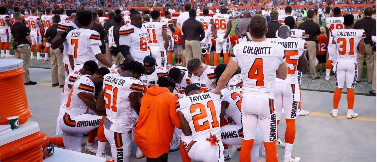 A group of Cleveland Browns players kneel in a circle in protest during the national anthem prior to a preseason game against the New York Giants at FirstEnergy Stadium on August 21, 2017 in Cleveland, Ohio. (Joe Robbins/Getty Images)