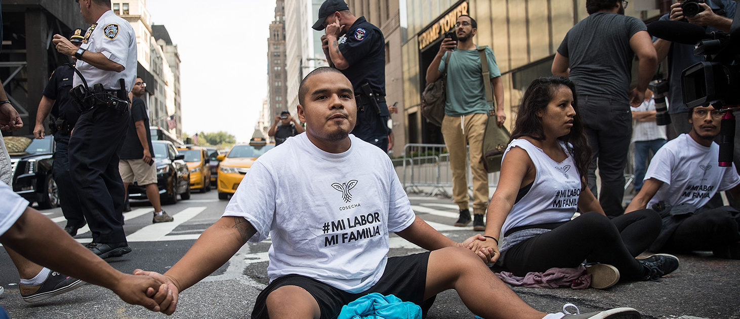 Immigration activists protesting the Trump administration's decision on the Deferred Action for Childhood Arrivals program sit in the street and block traffic on 5th Avenue near Trump Tower, September 5, 2017. On Tuesday, the Trump administration announced they will end the Deferred Action for Childhood Arrivals program, with a six month delay. The decision represents a blow to young undocumented immigrants (also known as 'dreamers') who were shielded from deportation under DACA. (Photo by Drew Angerer/Getty Images)
