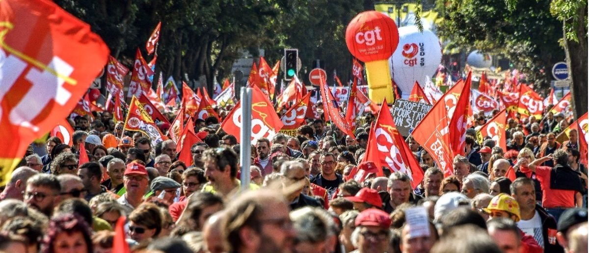 Thousands protest Macron in France. (PHILIPPE HUGUEN/AFP/Getty Images)