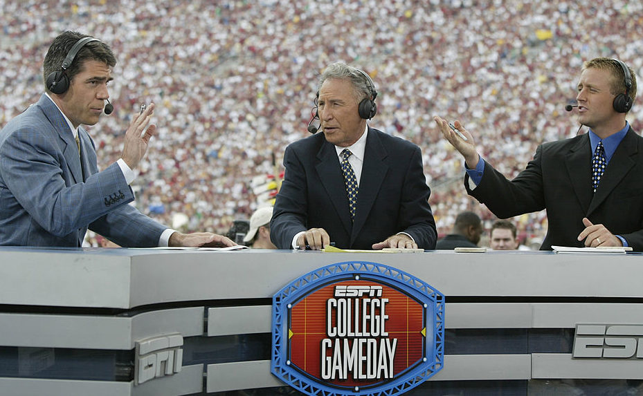 ESPN College GameDay announcers (l to r) Chris Fowler, Lee Corso and Kirk Herbstreit comment during the NCAA football game between Notre Dame and Florida State at Doak Campbell Stadium on October 26, 2002 in Tallahassee, Florida.  The Notre Dame Fighting Irish defeated the Florida State Seminoles 34-24.  (Photo by Craig Jones/Getty Images)