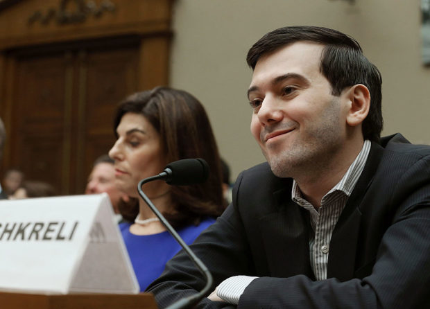 WASHINGTON, DC - FEBRUARY 04: Martin Shkreli, former CEO of Turing Pharmaceuticals LLC., smiles while flanked by Nancy Retzlaff, chief commercial officer for Turing Pharmaceuticals LLC., during a House Oversight and Government Reform Committee hearing on Capitol Hill, February 4, 2016 in Washington, DC. Mr. Shkreli invoked his 5th Amendment right not to testify to the committee that is examining the prescription drug market. (Photo by Mark Wilson/Getty Images)
