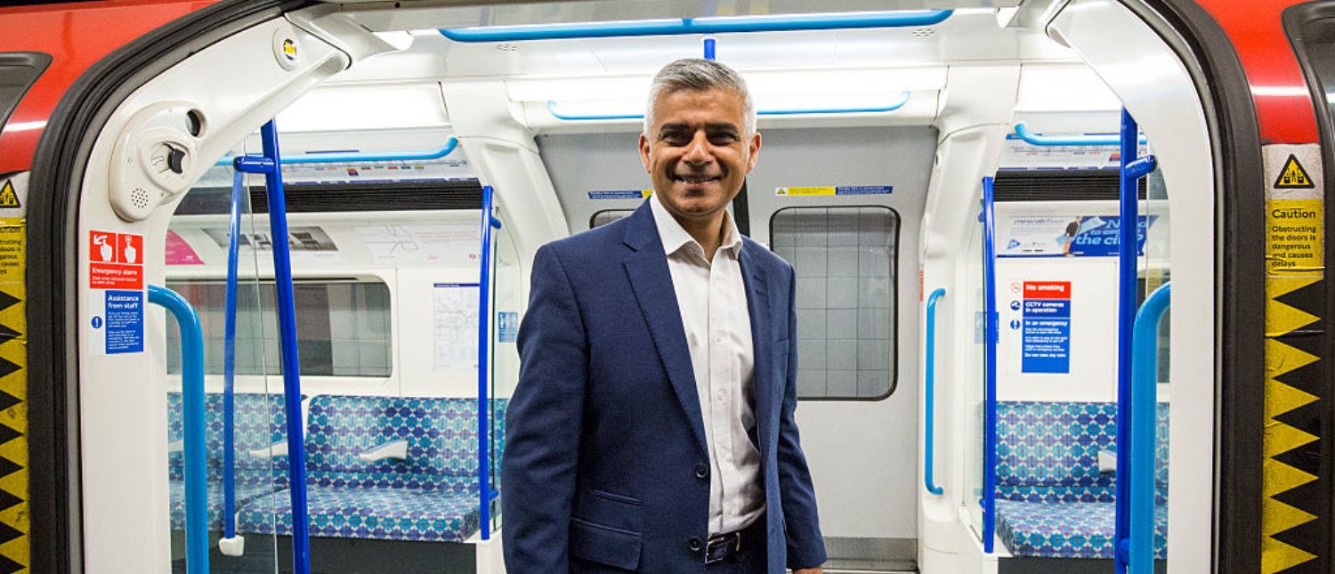 LONDON, ENGLAND - AUGUST 20: London Mayor Sadiq Khan poses in front of the open doors of a train car during the first Night Tube train to leave from Brixton Underground Station on August 20, 2016 in London, England. (Photo by Jack Taylor/Getty Images)
