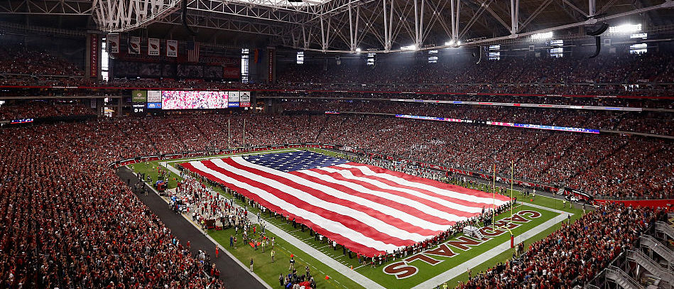 GLENDALE, AZ - SEPTEMBER 11: The American flag is draped across the field for the national anthem to the NFL game between the Arizona Cardinals and the New England Patriots at the University of Phoenix Stadium on September 11, 2016 in Glendale, Arizona. (Photo by Christian Petersen/Getty Images)