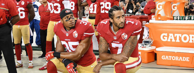 Colin Kaepernick #7 and Eric Reid #35 of the San Francisco 49ers kneel in protest during the national anthem prior to playing the Los Angeles Rams in their NFL game at Levi's Stadium on September 12, 2016 in Santa Clara, California. (Photo by Thearon W. Henderson/Getty Images)