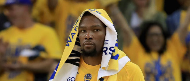 OAKLAND, CA - MAY 16:  Kevin Durant #35 of the Golden State Warriors stands by the bench during their game against the San Antonio Spurs at ORACLE Arena on May 16, 2017 in Oakland, California.  NOTE TO USER: User expressly acknowledges and agrees that, by downloading and or using this photograph, User is consenting to the terms and conditions of the Getty Images License Agreement.  (Photo by Ezra Shaw/Getty Images)