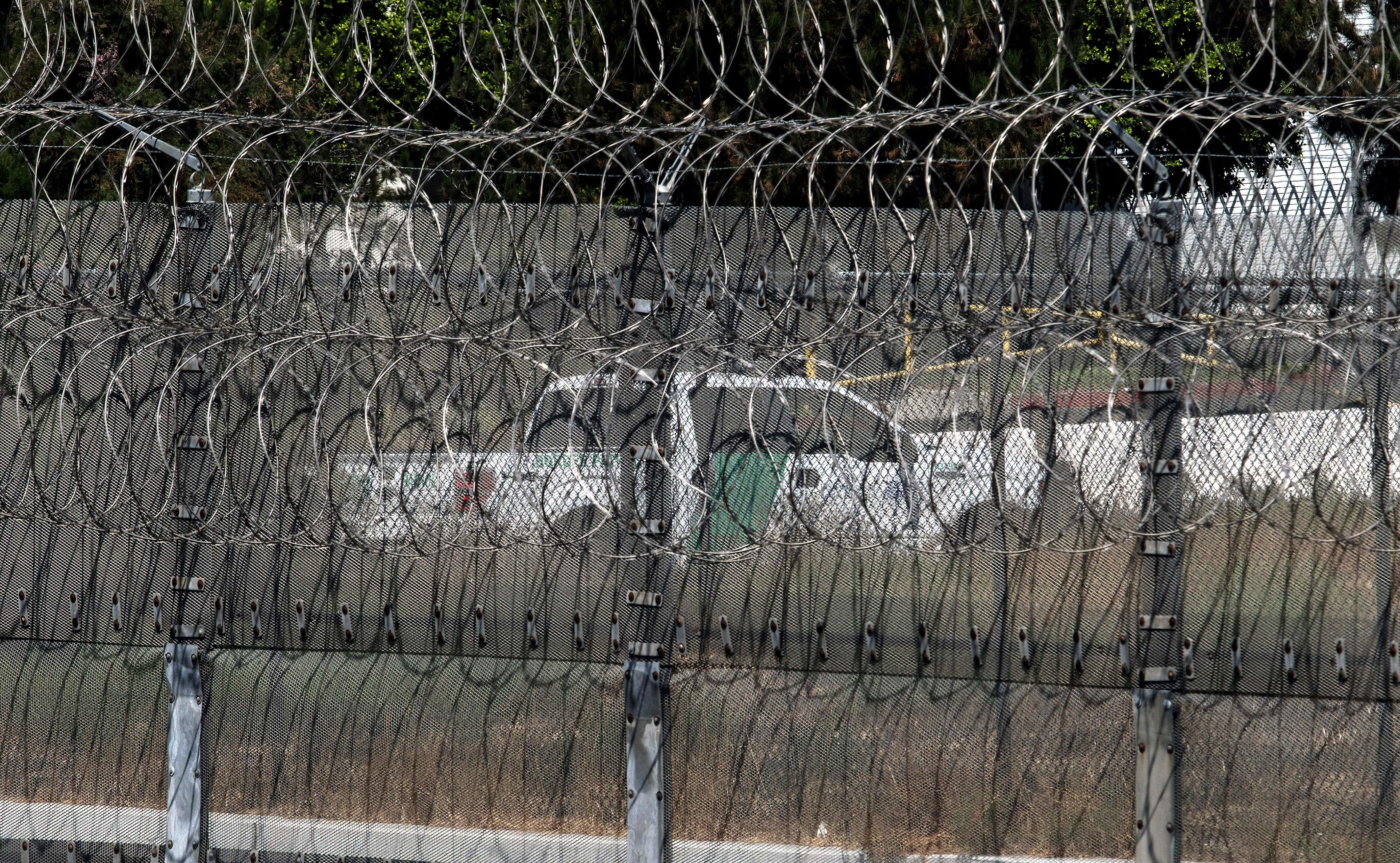 A Border Patrol vehicle is seen through the border fence near the exit of a tunnel used to smuggle people found at the US-Mexico border on August 27, 2017 in Tijuana, northwestern Mexico.