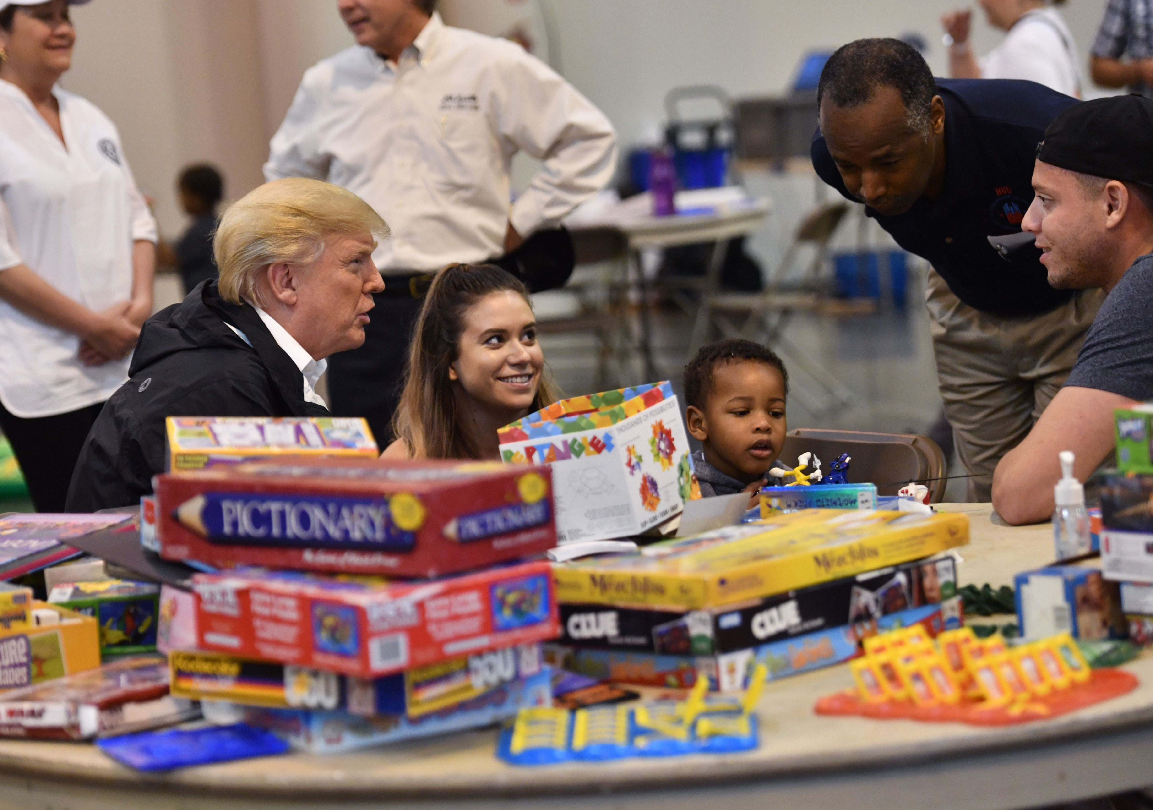 US President Donald Trump, with Secretary of Housing and Urban Development Ben Carson (2nd R), visits Hurricane Harvey victims at NRG Center in Houston on September 2, 2017. US President Donald Trump, with visits Hurricane Harvey victims at NRG Center in Houston on September 2, 2017. NICHOLAS KAMM/AFP/Getty Images