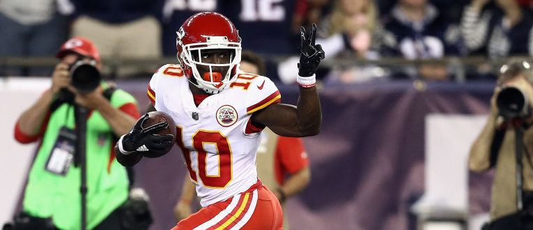 Tyreek Hill #10 of the Kansas City Chiefs celebrates by giving a peace sign to the Patriots trying to catch him before he makes a touchdown during the third quarter against the New England Patriots at Gillette Stadium on September 7, 2017 in Foxboro, Massachusetts. (Photo by Maddie Meyer/Getty Images)