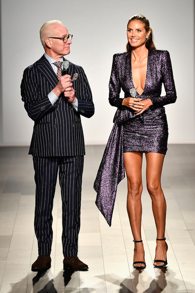 NEW YORK, NY - SEPTEMBER 08: Tim Gunn (L) and Heidi Klum speak on the runway at the Project Runway fashion show during New York Fashion Week: The Shows at Gallery 1, Skylight Clarkson Sq on September 8, 2017 in New York City. (Photo by Frazer Harrison/Getty Images For NYFW: The Shows)
