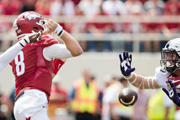 FAYETTEVILLE, AR - SEPTEMBER 9: Austin Allen #8 of the Arkansas Razorbacks has a pass knocked out of his hands during a game against the TCU Horned Frogs at Donald W. Reynolds Razorback Stadium on September 9, 2017 in Fayetteville, Arkansas. (Photo by Wesley Hitt/Getty Images)
