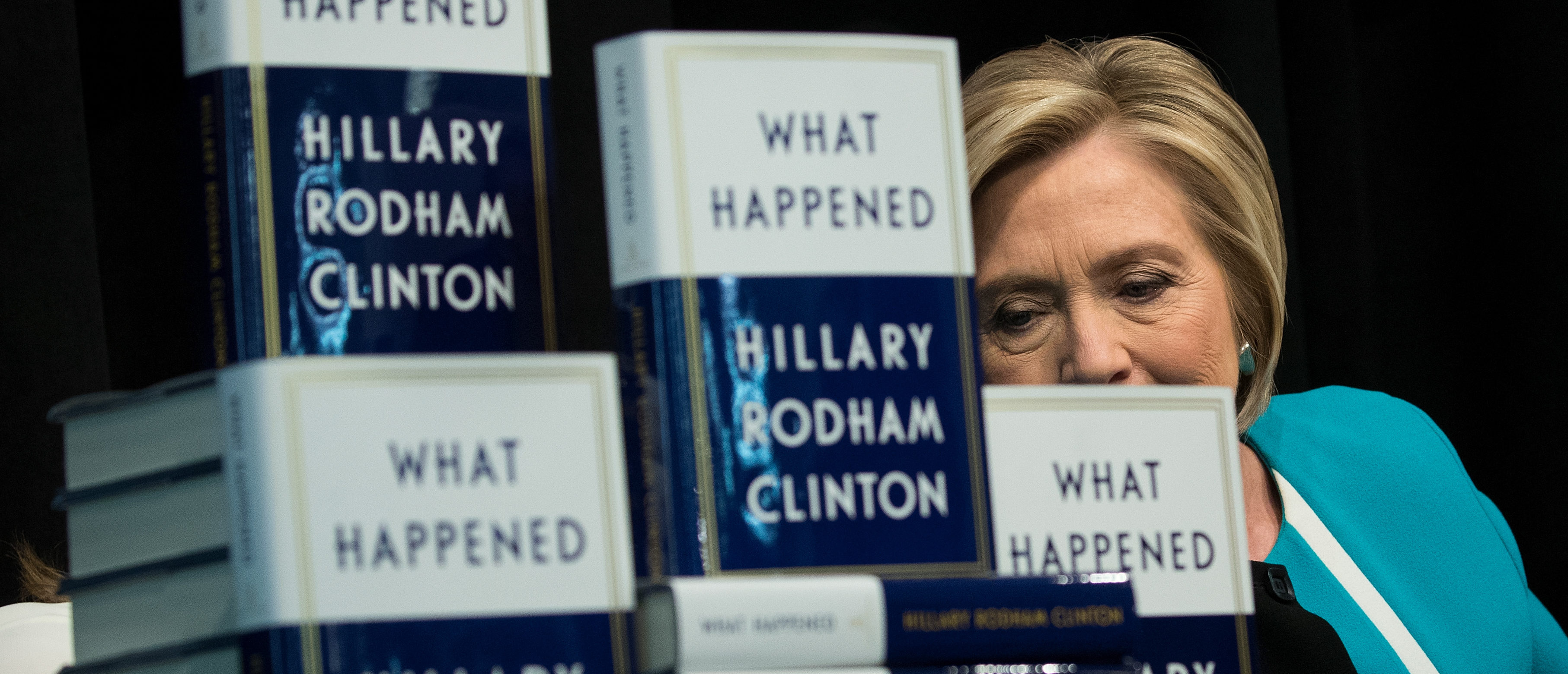 "NEW YORK, NY - SEPTEMBER 12: Former U.S. Secretary of State Hillary Clinton signs copies of her new book ""What Happened"" during a book signing event at Barnes and Noble bookstore September 12, 2017 in New York City. Clinton's book, which focuses on her 2016 election loss to President Donald Trump, goes on sale today. (Photo by Drew Angerer/Getty Images)"