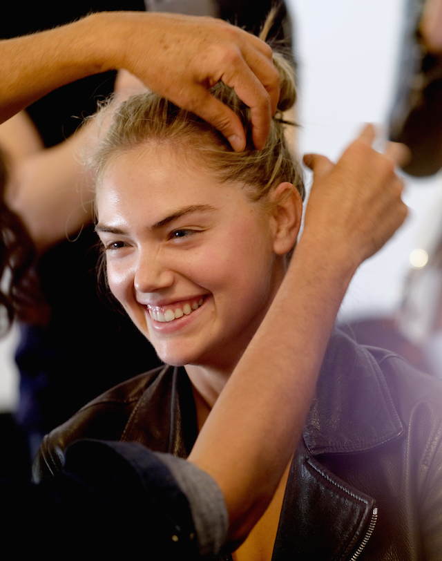 NEW YORK, NY - SEPTEMBER 13: Kate Upton prepares backstage at Michael Kors Collection Spring 2018 Runway Show at Spring Studios on September 13, 2017 in New York City. (Photo by Dimitrios Kambouris/Getty Images for Michael Kors)