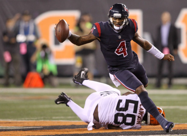 CINCINNATI, OH - SEPTEMBER 14: Deshaun Watson #4 of the Houston Texans breaks a tackle from Carl Lawson #58 of the Cincinnati Bengals as he runs for a touchdown during the first half at Paul Brown Stadium on September 14, 2017 in Cincinnati, Ohio. (Photo by John Grieshop/Getty Images)