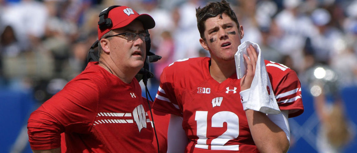 Head coach Paul Chryst of the Wisconsin Badgers and his quarterback Alex Hornibrook #12 look at a replay during a game against the BYU Cougars at LaVell Edwards Stadium on September 16, 2017 in Provo, Utah. (Photo by Gene Sweeney Jr/Getty Images)