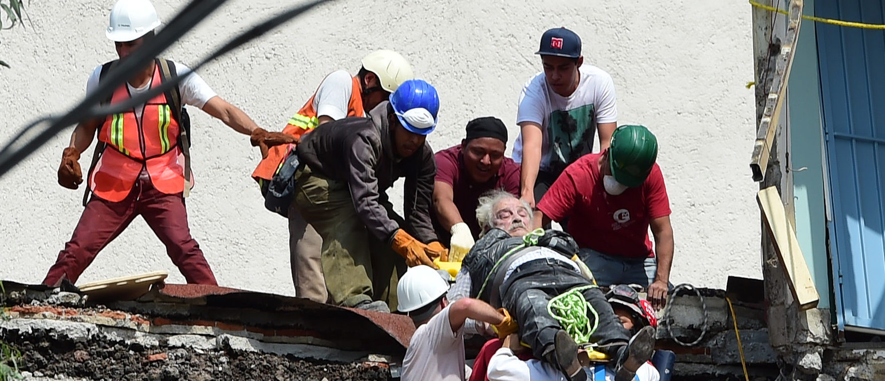 A man is pulled out of the rubble alive following a quake in Mexico City on September 19, 2017.