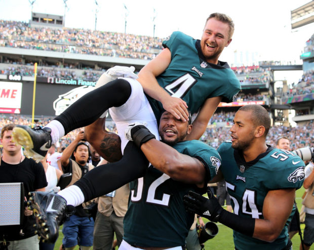 PHILADELPHIA, PA - SEPTEMBER 24: Jake Elliott #4 of the Philadelphia Eagles is picked up by teammates Najee Goode #52 and Kamu Grugier-Hill #54 after Elliott kicked the game winning field goal with 1 second left in the game against the New York Giants on September 24, 2017 at Lincoln Financial Field in Philadelphia, Pennsylvania.Elliott kicked the 61 yard field goal to defeat the New York Giants 27-24. (Photo by Elsa/Getty Images)