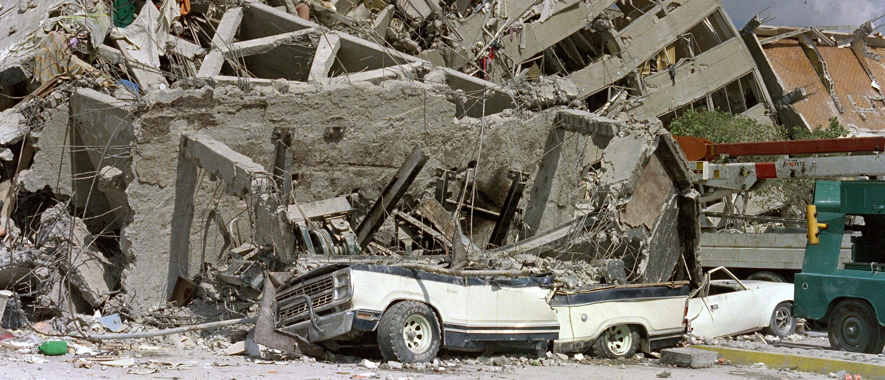 """Rescue workers and volunteers sift through the rubble of a collapsed building in """"Zona Rosa"""" area of Mexico City, a popular commercial and tourist area, 21 September1985, after an earthquake leveled parts of the city 19 September 1985. JONATHAN UTZ/AFP/Getty Images"""