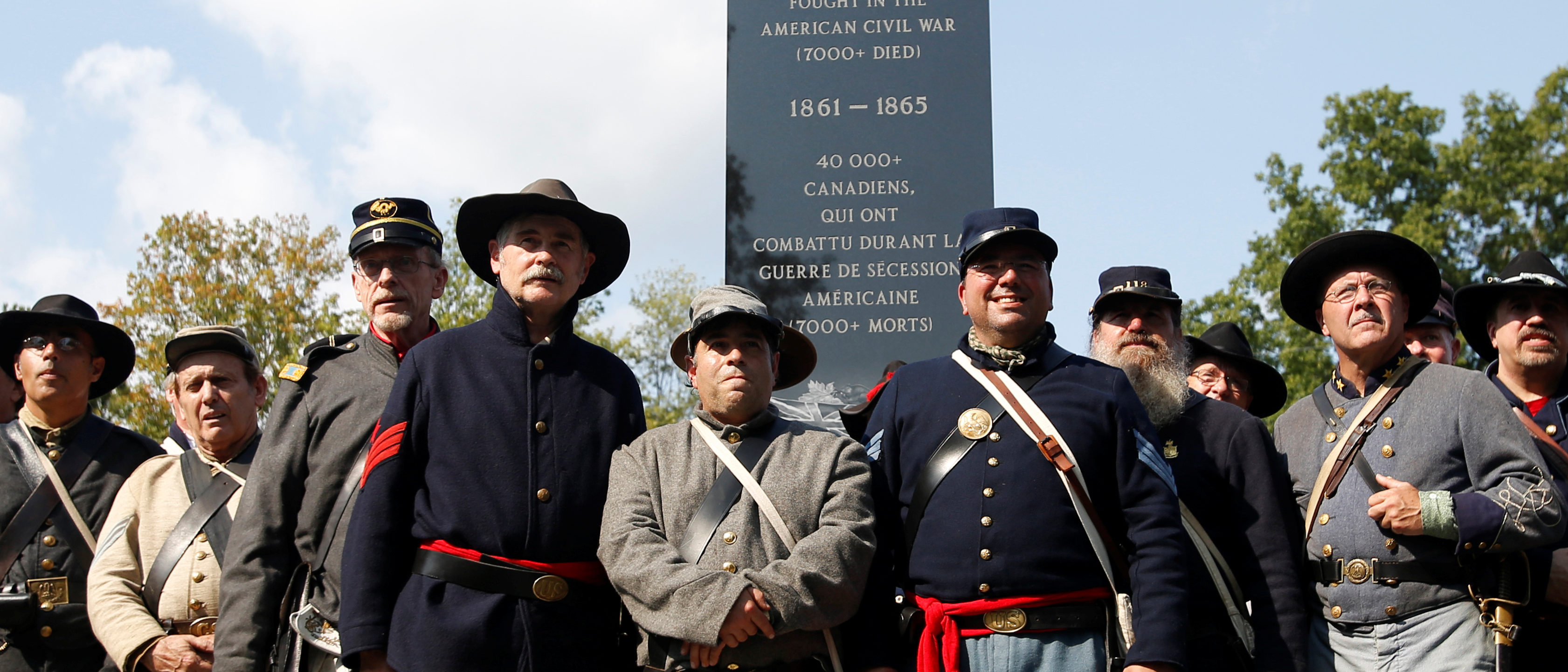 Re-enactors pose for a group photo in front of a monument honouring Canadians who fought in the U.S. Civil War during a dedication ceremony at Ault Park in Long Sault, Ontario, Canada, September 16, 2017. REUTERS/Chris Wattie - RC181C63C540
