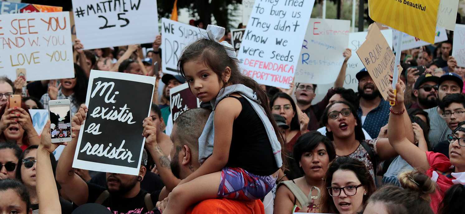 Deferred Action for Childhood Arrivals (DACA) program supporters rally at City Hall in Los Angeles, California, September 5, 2017. REUTERS/ Kyle Grillot