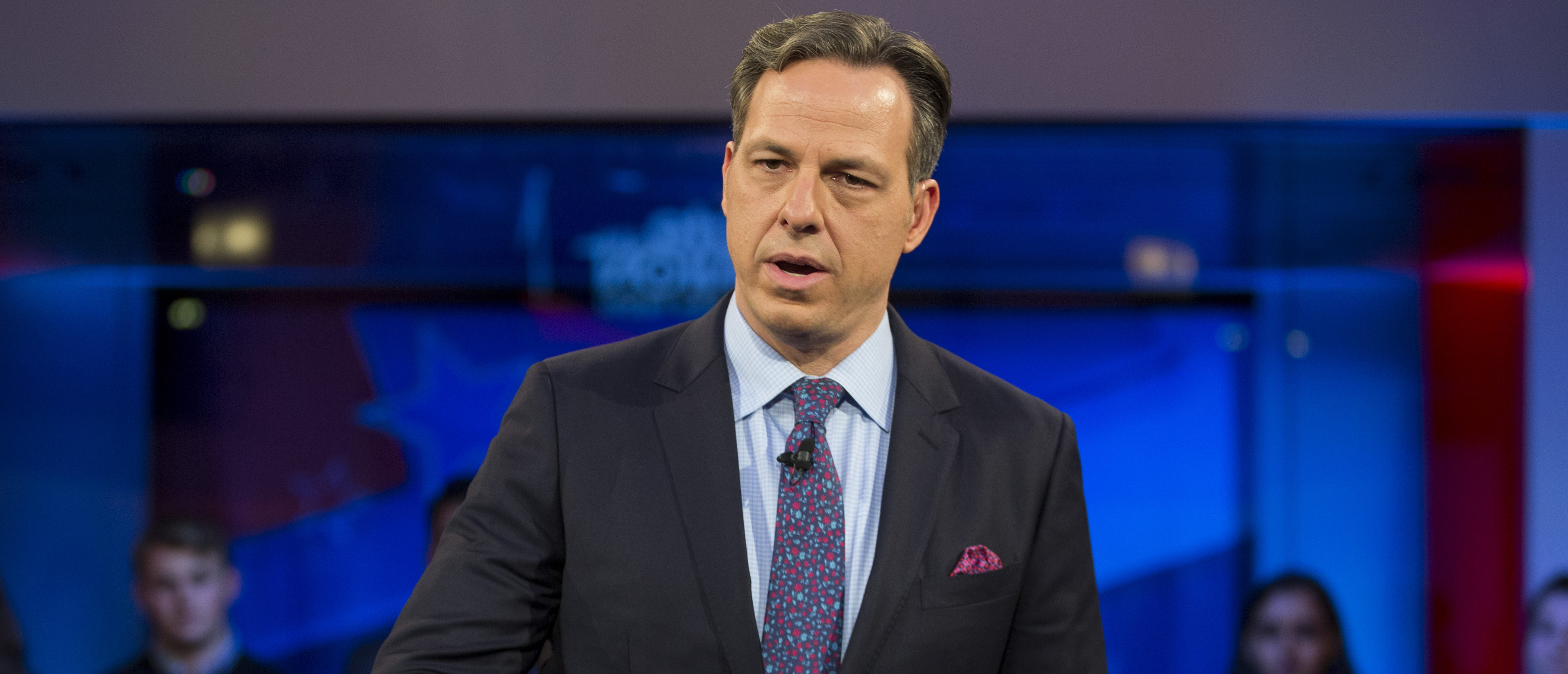 "CAMBRIDGE, MA - DECEMBER 01: Jake Tapper, of CNN's State of the Union, speaks to a crowd at the Harvard Institute of Politics Forum before Trump Campaign Manager Kellyanne Conway and Clinton Campaign Manager Robby Mook enter the room for an event titled ""War Stories: Inside Campaign 2016"" on December 1, 2016 in Cambridge, Massachusetts. (Photo by Scott Eisen/Getty Images)"