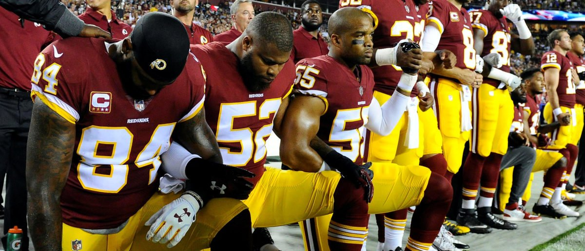 Sep 24, 2017; Landover, MD, USA; Washington Redskins tight end Niles Paul (84) and linebacker Ryan Anderson (52) and Washington Redskins linebacker Chris Carter (55) kneel with teammates during the playing of the national anthem before the game between the Washington Redskins and the Oakland Raiders at FedEx Field. [Credit: Brad Mills-USA TODAY Sports]
