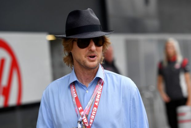 US actor Owen Wilson walks in the pit lane ahead of the British Formula One Grand Prix at the Silverstone motor racing circuit in Silverstone, central England on July 16, 2017. (Photo credit: ANDREJ ISAKOVIC/AFP/Getty Images)