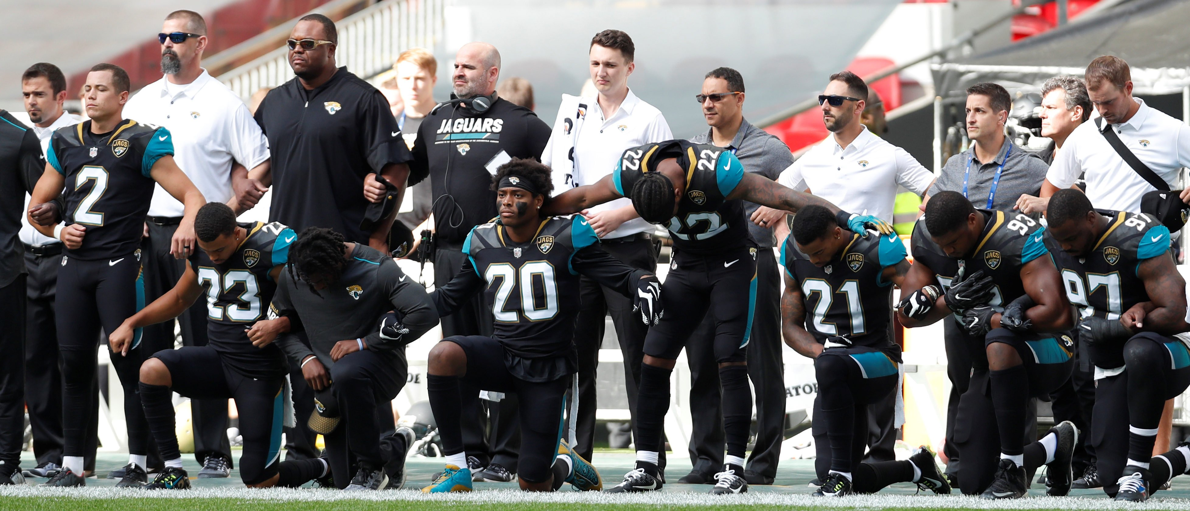 NFL players controversially kneel during the national anthem via Reuters